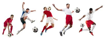 Professional men - football soccer players with ball isolated white studio background. Professional football soccer players with ball isolated on white studio royalty free stock photo