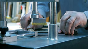Professional framer hand holding frame angle, working on machine royalty free stock photography