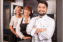 Professional friendly chefs are working in bakery Stock Images