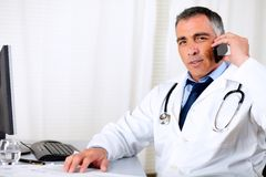 Professional friendly senior doctor Royalty Free Stock Photo