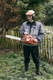 Professional gardener with chainsaw Royalty Free Stock Image