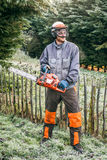 Professional gardener with chainsaw Royalty Free Stock Images