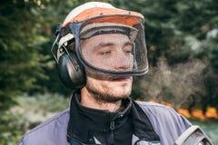 Professional gardener in helmet Royalty Free Stock Image