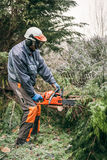 Professional gardener using chainsaw Stock Photos
