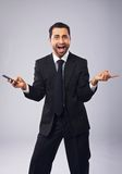 Professional Gesturing While Holding a Phone Stock Photo