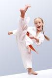 Professional girl does karate kick royalty free stock photos