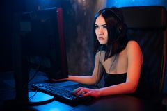Professional Girl Gamer Plays in MMORPG or Strategy Video Game on Her Computer. She`s Participating in Online Cyber. Games Tournament, Plays at Home, or in stock photos