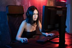 Professional Girl Gamer Plays in MMORPG or Strategy Video Game on Her Computer. She`s Participating in Online Cyber. Games Tournament, Plays at Home, or in stock photo
