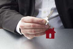Professional giving a key to your property Stock Photography
