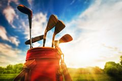 Professional golf clubs at sunset
