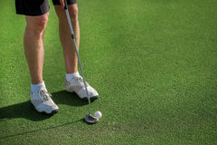 Professional Golf Course. Golfer holding a a club and is going t Royalty Free Stock Image