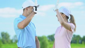 Professional golf players giving high five to each other after end of tournament. Stock footage stock footage