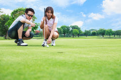 Professional golfer teaching to play golf Royalty Free Stock Photos