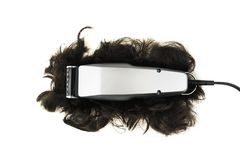 Professional hair clipper. Professional grey hair clipper with cropped black hair isolated on white background stock image