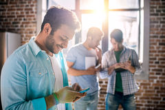 Professional group working on new business project in small business office Stock Image