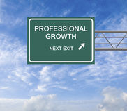 Professional growth. Road Sign to professional growth stock photo
