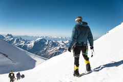 Professional guide - climber on the snow-covered summit of Elbrus sleeping volcano Stock Photography