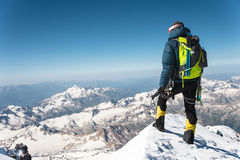 Professional guide - climber on the snow-covered summit of Elbrus sleeping volcano Royalty Free Stock Photography