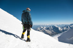 Professional guide - climber on the snow-covered summit of Elbrus sleeping volcano Stock Photo