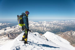 Professional guide - climber on the snow-covered summit of Elbrus sleeping volcano Royalty Free Stock Photos