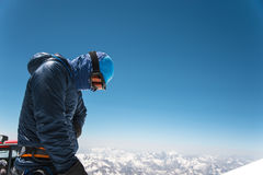 Professional guide - climber on the snow-covered summit of Elbrus sleeping volcano Royalty Free Stock Images
