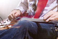 Professional Guitar Player with Electric Guitar Hands Closeup. S Royalty Free Stock Image