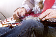 Professional Guitar Player with Electric Guitar Hands Closeup. S Royalty Free Stock Photo
