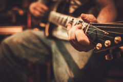 Professional guitarists performing in boutique recording studio royalty free stock photo