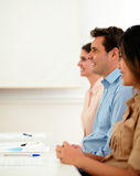Professional guy listen and sitting on a meeting Royalty Free Stock Photography