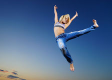 Professional gymnast. Woman at night Royalty Free Stock Images