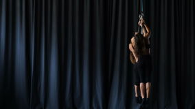 Professional gymnasts performs a trick on the aerial hoop stock video