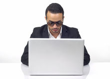 Professional hacker working on laptop Stock Photo