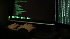 Professional hacker working at night, trying to break into system, cybercrime