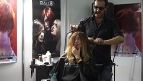 Professional hair cutting in beauty salon stock video footage