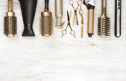 Professional hair dresser tools on wooden background with copy space royalty free stock images