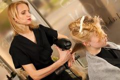 professional hair stylist at work hairdresser doing hairstyle stock image - Professional Hair Stylist