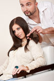 Professional hairdresser choose hair dye color Royalty Free Stock Photo