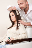 Professional hairdresser choose hair dye color Royalty Free Stock Image