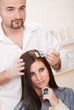 Professional hairdresser color customer at salon Stock Photography