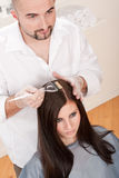 Professional hairdresser color customer at salon Royalty Free Stock Photo