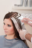 Professional hairdresser color customer at salon Stock Photos