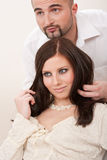 Professional hairdresser comb customer at salon Stock Image