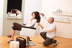 Professional hairdresser comb customer at salon Royalty Free Stock Photos