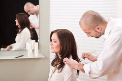 Professional hairdresser comb customer at salon Stock Photo