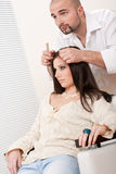 Professional hairdresser comb female customer Royalty Free Stock Photos