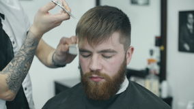 Professional hairdresser combing hair stock video footage