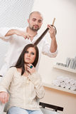 Professional hairdresser cut with scissors Stock Photo