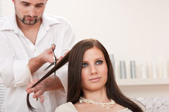 Professional hairdresser cut with scissors Royalty Free Stock Photo