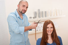 Professional hairdresser cut with scissors Royalty Free Stock Photography