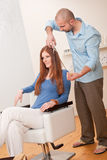 Professional hairdresser cut with scissors Stock Photos